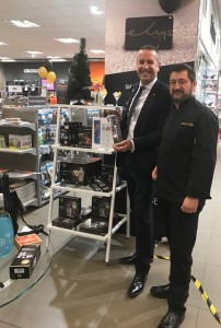 Above: Peter at Ely's of Wimbledon with David Hordle, managing director of the Morley Group.