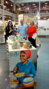 Above: HousewaresNews' Jo Howard looks at the Nadiya from BlissHome range with Mike and Gabrielle Bliss in Top Drawer's Home section.