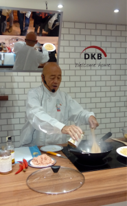 Above: Ken using one of his new woks.