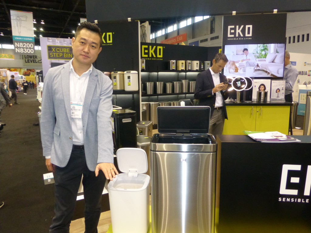 Above: EKO's Alex Bian with some of the company's innovative new sensor bins at Chicago's IH+HS in March.