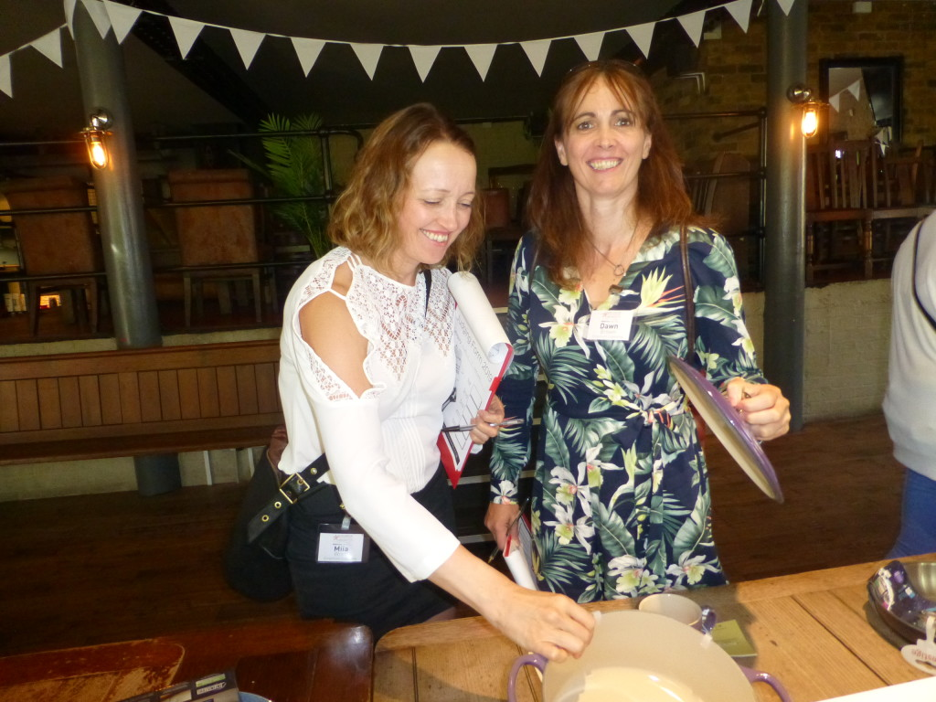 Above: Miia Wren and Dawn Brown of Emporium Cookshop look at cookware entries.