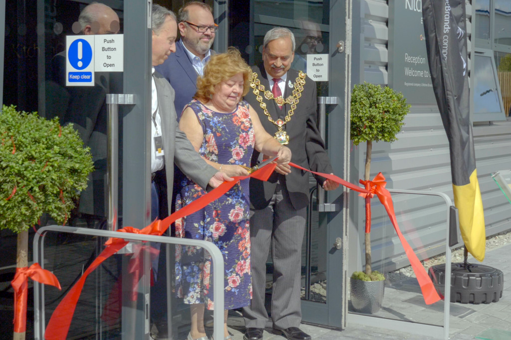Above:  Noreen Sweeney, sales office manager cuts the ribbon to open the new HQ.