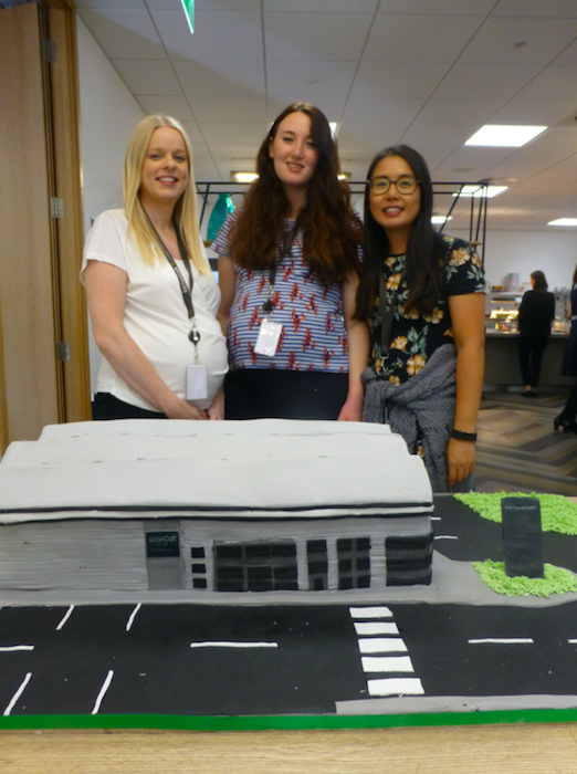 Above: KitchenCraft's Lucy Lynch, Ellie McIntyre and Steffi Law beside the celebratory cake in the shape of the new HQ.