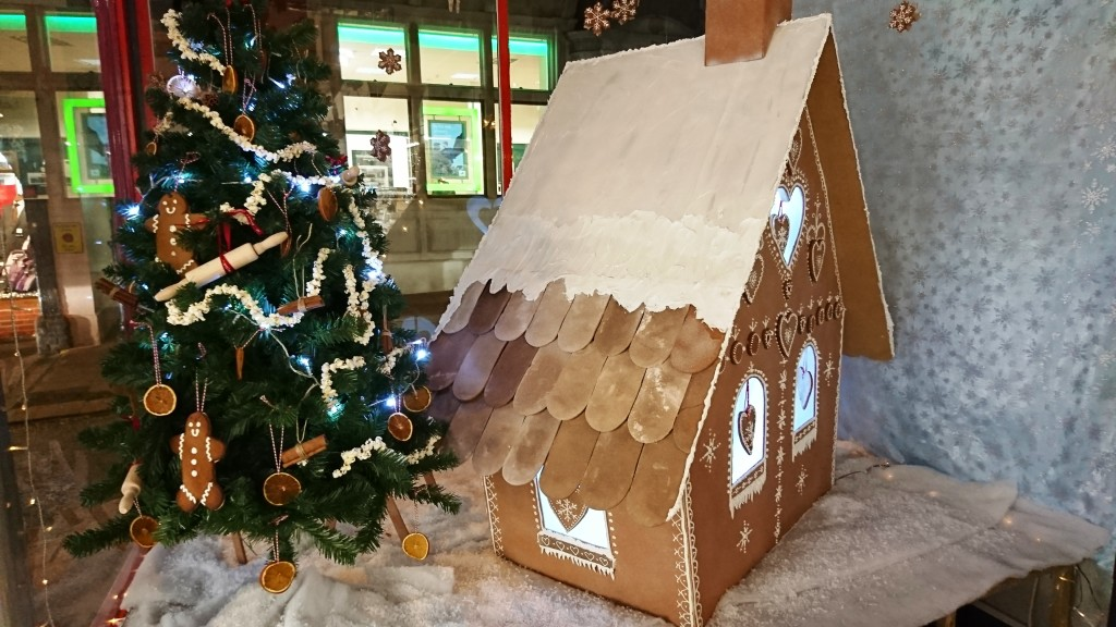 Above: The Christmas Gingerbread window featured a four foot high gingerbread house made from hardwood, saltdough tiles and piped with decorators' caulking.
