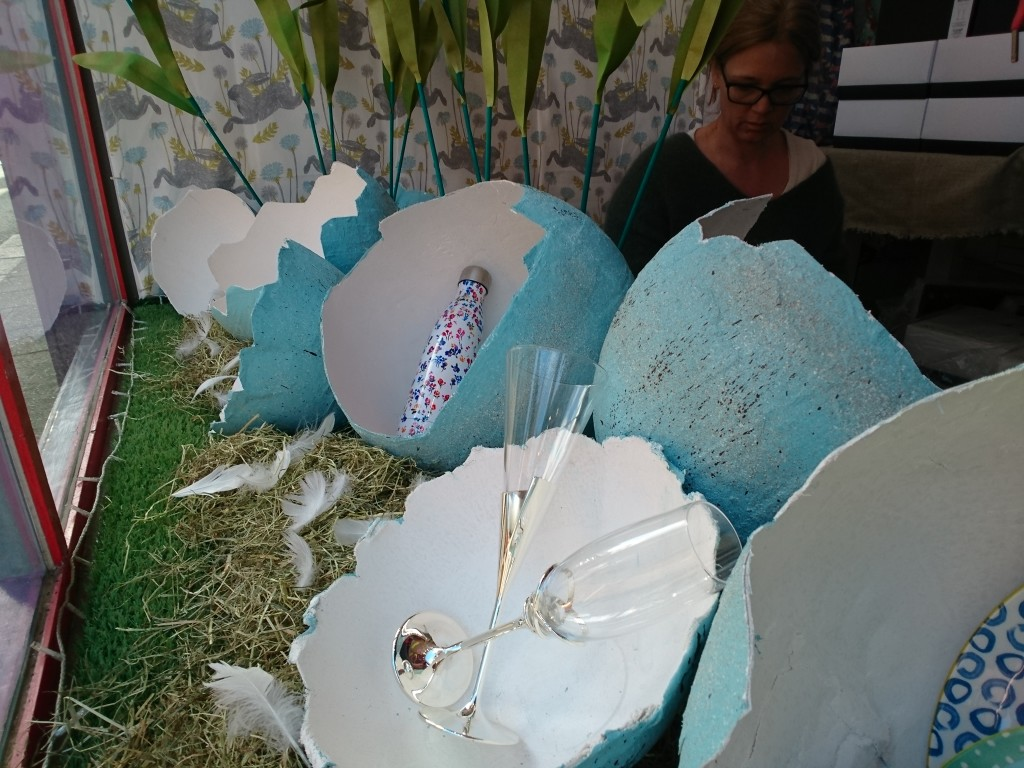 Above: The Easter Spring window with oversize eggs made using plaster of paris to display products.