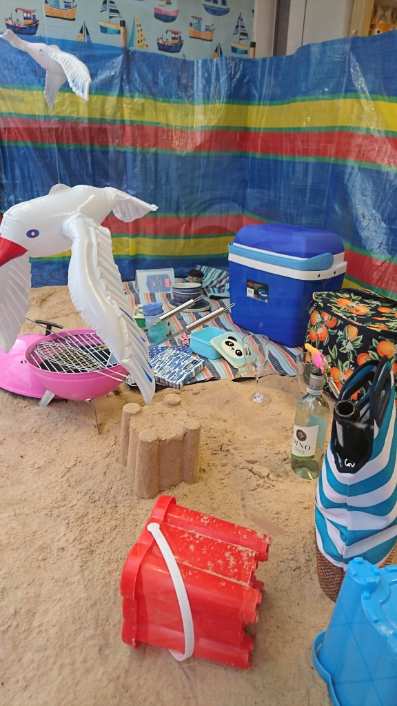 Above: Featuring real sand the Summer Beach window laid out a beach picnic scene with sand, seagulls, windbreak and a bbq.