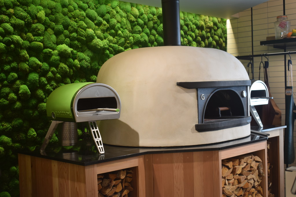 Above: Pizza ovens against the living wall of moss – a feature of Harrods' Kitchen and Household department.