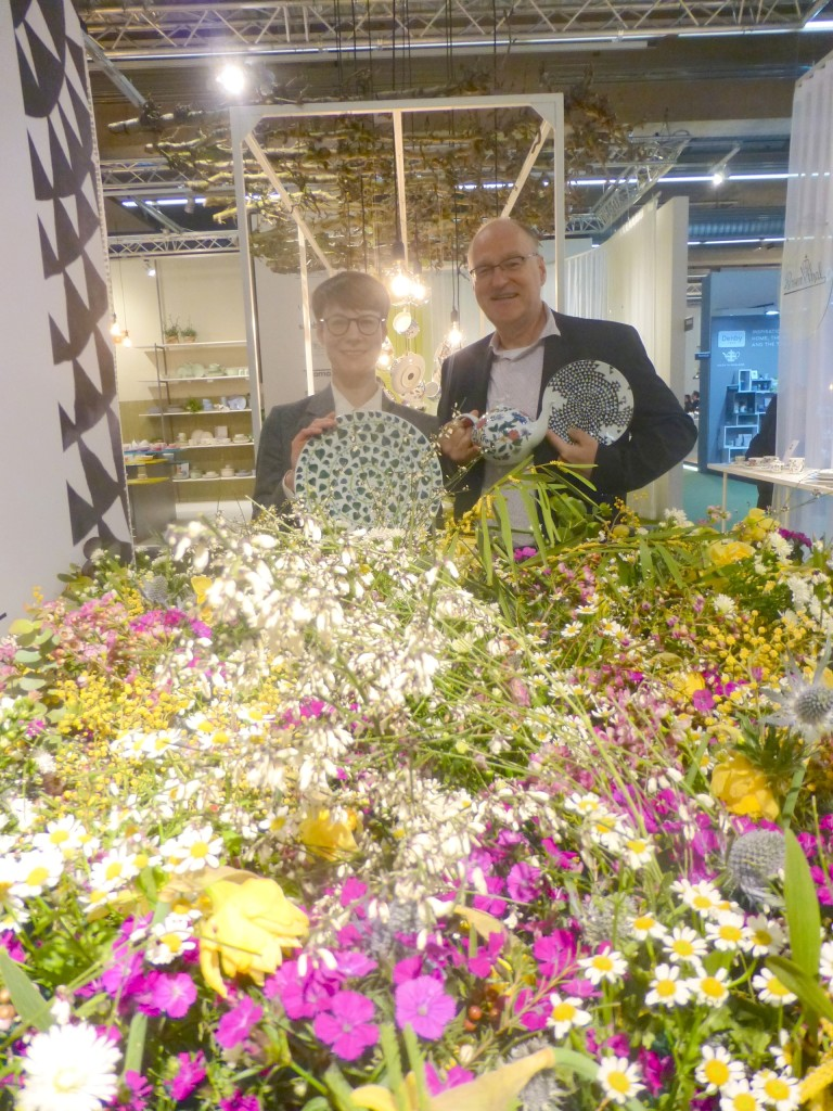 Above: Rosenthal's Maik Hagemann, marketing services manager and Iris Reichstein, head of PR holding some of the new Magic Garden pieces besides the flower meadow on Rosenthal's stand.