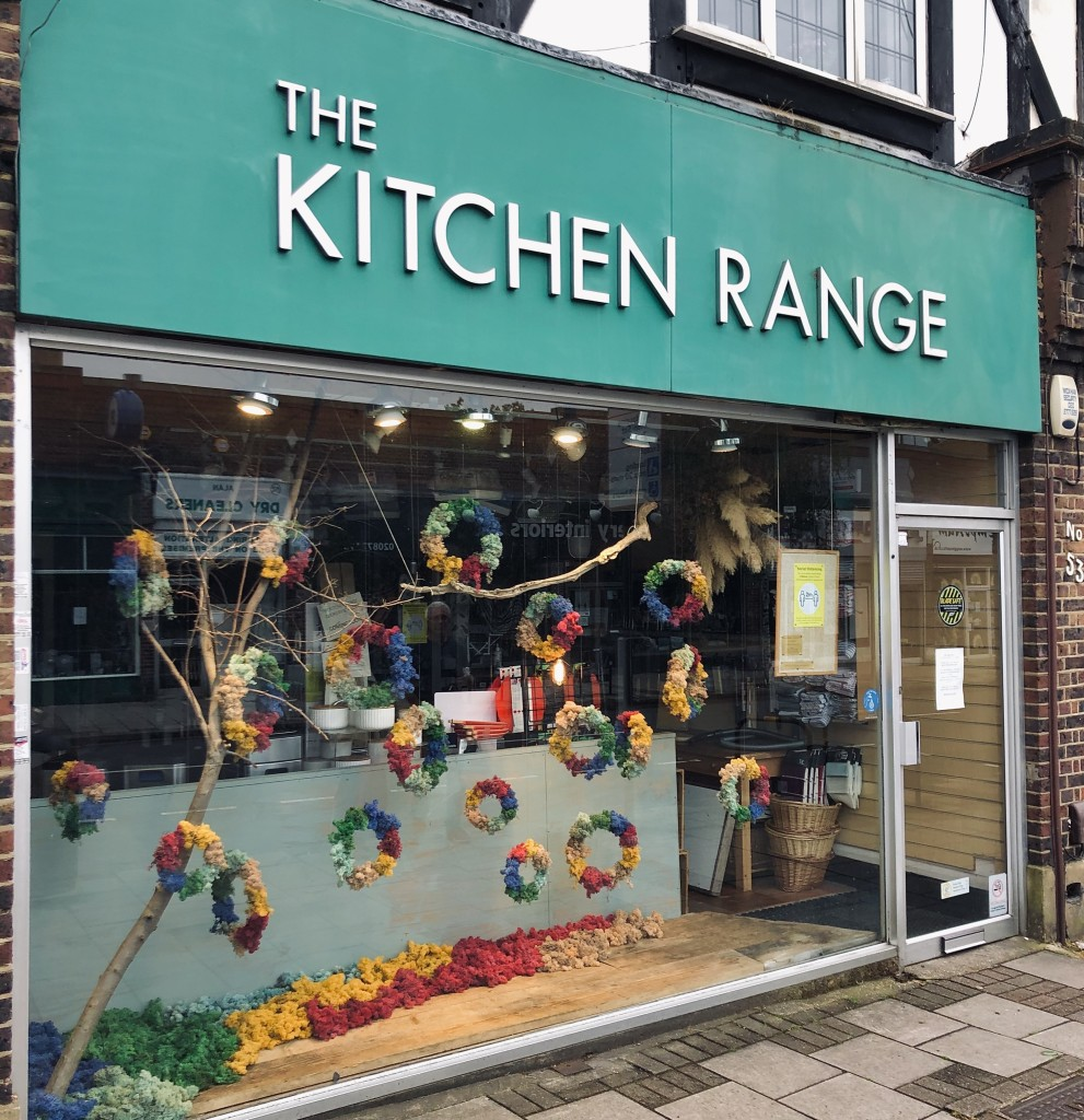 Above: The rainbow window (featuring coloured moss) for The Kitchen Range's re-opening in West Wickham.