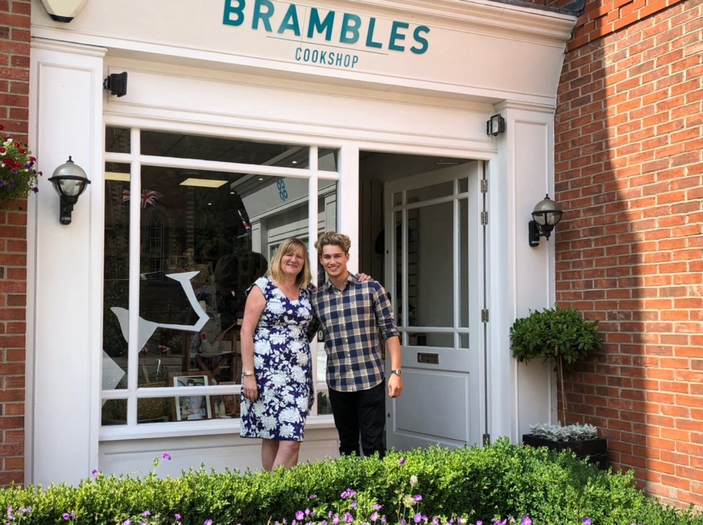 Above: Lisa Austin with local customer AJ Pritchard outside Brambles.