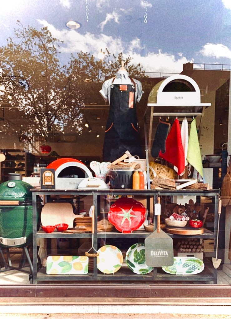 Above: Big Egg and Delivita ovens, along with outdoor dining wares in Divertimenti's windows.