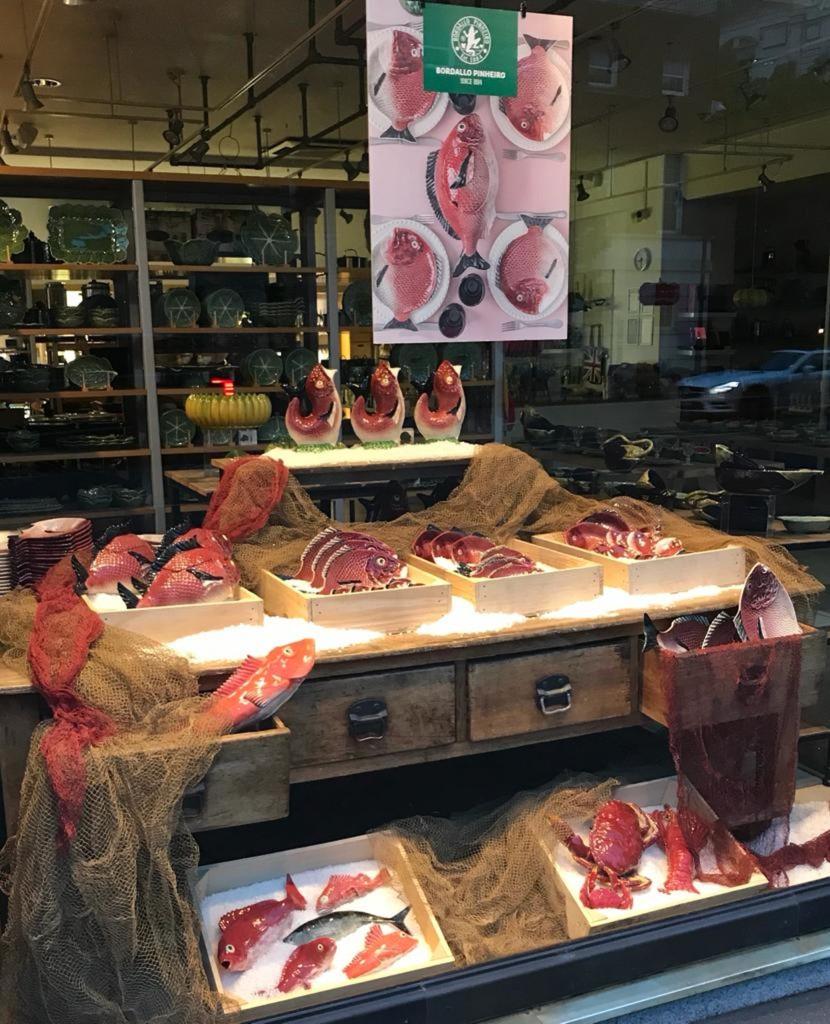 Above: Market style display for Bordallo Pinheiro fish plates at Divertimenti.